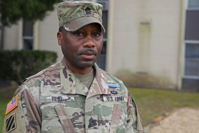 Command Sgt. Maj. Curtis Reid, the senior enlisted advisor for 1st Battalion, 28th Infantry Regiment, 3rd Infantry Division, poses for a photo March 3, 2021, at Fort Benning, Georgia. Reid, a Silver Star recipient, earned the award for rescuing numerous Soldiers from a burning Bradley Fighting Vehicle in Iraq in 2006.