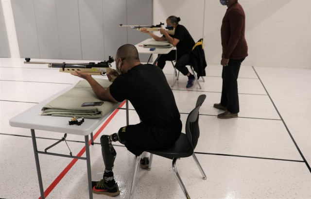 U.S. Army Staff Sgt. Gene Calantoc, and Master Sgt. Mary Jackson, Soldier Recovery Unit, Brooke Army Medical Center, shoot for record during the Virtual Army Trials air rifle event at Cole High School, Fort Sam Houston, Texas, March 4, 2021. Both Calantoc and Jackson are among several other BAMC SRU Soldiers vying for selection to Team Army to compete in the DoD Warrior Games in September.  (U.S. Army photo by Robert A. Whetstone)