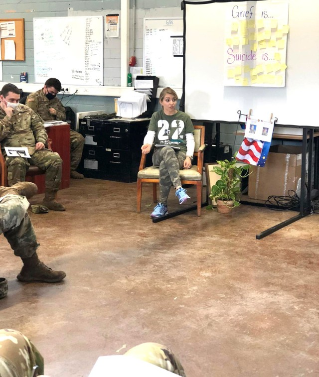 Laura Roman, U.S. Army Garrison Rheinland-Pfalz Army Substance Abuse Program Risk Reduction coordinator, talks with members of a unit about dealing with the grief they can expect after losing two fellow Soldiers to suicide in late 2020.