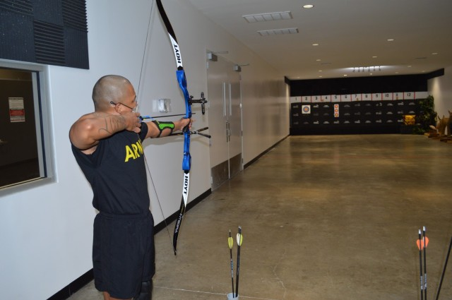 U.S. Army Staff Sgt. Gene Calantoc, a member of the Soldier Recovery Unit at Brooke Army Medical Center, prepares to loose an arrow during the Virtual Army Trials archery event held at Buck and Doe's Mercantile in San Antonio, Texas, March 10, 2021. Calantoc is one of several Soldiers at the SRU competing to be selected to represent Team Army in the 2021 DoD Warrior Games. (U.S. Army photo by Daniel J. Calderón)
