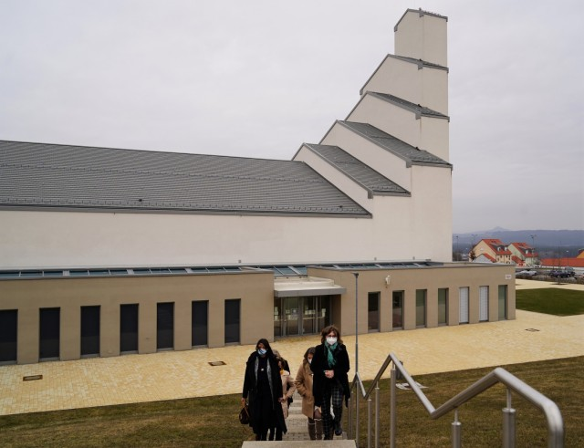 The tour travels from the Netzaberg Chapel, in the backdrop, to the out-of-view child development center, March 11, 2021.