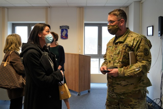 Angela Abernethy, spouse of U.S. Army Europe and Africa Command Sgt. Maj. Rob Abernethy, speaks to Col. E. Lee Bryan, commander of MEDDAC-Bavaria, about the Behavior Health program, March 11, 2021.