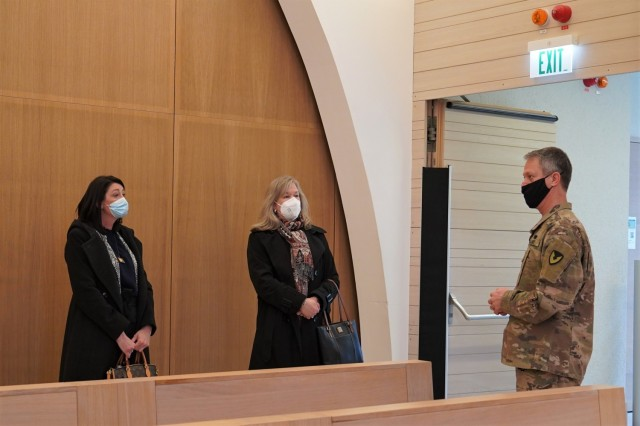 The military spouses are provided a tour of the Netzaberg Chapel, March 11, 2021. From the right, Family Life Chaplain Maj. Rick Pak speaks with Kathy Norrie and Angela Abernethy about the wide range of religious services offered to Soldiers and their families — many of which are now offered virtually.