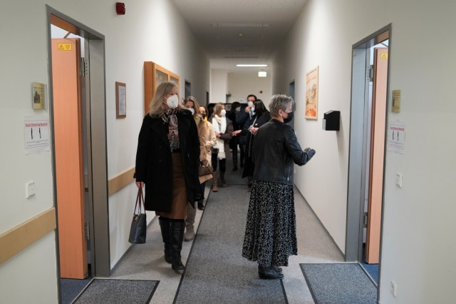 Housing Division Chief Norma Trassl guides the tour through the hallways of Tower Barracks Bldg. 244 to her team's workstations, March 11, 2021.