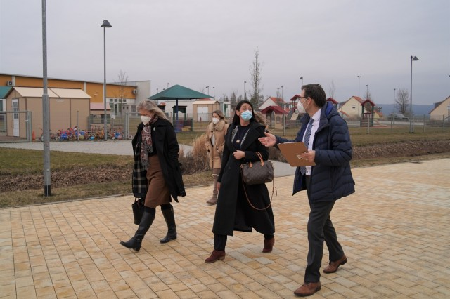 The tour continues through the Netzaberg community, USAG Bavaria's largest housing area, to view the local chapel, school grounds and child care services, March 11, 2021. To the right, Deputy Commander Howard Johnston continues to brief Angela Abernethy, spouse of U.S. Army Europe and Africa Command Sgt. Maj. Rob Abernethy, about the off-post community and its offerings.