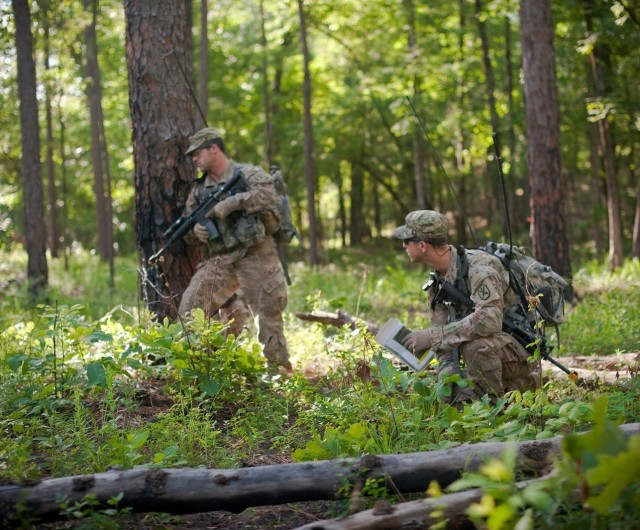 FORT BENNING, Ga. – In a June 2016 photo, students enrolled in Fort Benning's Maneuver Captain's Career Course (MCCC) take part in a field training exercise. Officers, including those attending the Maneuver Captain's Career Course here, are among those leaders who are now taking part in Project Athena, which the Army has adopted to help officers and noncommissioned officers (NCOs)in their professional self-development. Athena uses a battery of online self-assessments to help leaders gauge their strengths and shortcomings, after which they draw up an action plan and consult a more experienced leader on how to best pursue their development goals. At Fort Benning, in addition to captains in MCCC, lieutenants use Athena while attending the basic officer leader course for their assigned branch, ABOLC for Armor, and I-BOLC for Infantry. For maneuver branch NCOs, Fort Benning is currently setting up Athena within its advanced leaders course, or ALC, which includes Armor ALC and Infantry ALC. The next ALC classes are scheduled to start here March 26.