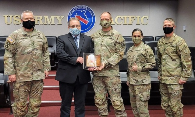 Gen. Paul LaCamera, Commanding General of the USARPAC, congratulates Brig. Gen. Timothy Connelly, Commanding General of the 9th Mission Support Command, and the Safety Team of the 9th MSC for winning the Army Organization Safety Award from the Department of Army for the first time in the unit's history.