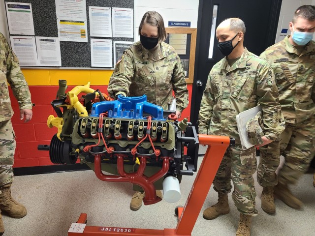 Command Sgt. Maj. Petra M. Casarez and Chief Warrant Officer 5 Danny K. Taylor check out the static engine display used during basic and advanced level Wheeled Vehicle Mechanic (91B10/30) courses at RTS-M, Fort Bragg.