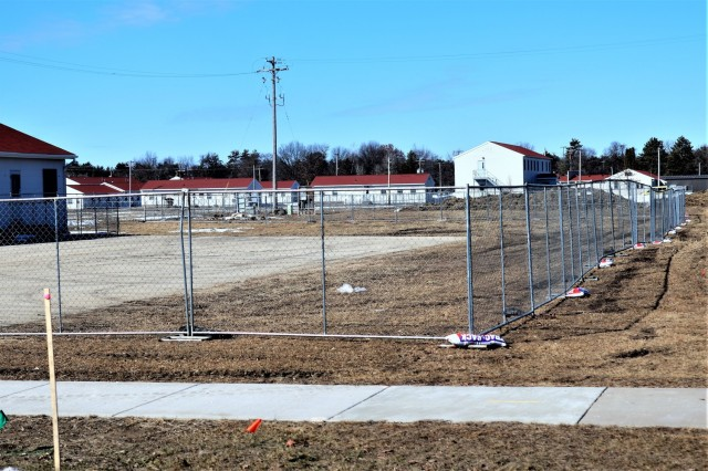 Construction fences are shown set up March 4, 2021, in the 1600 block of the cantonment area at Fort McCoy, Wis. The fences are in place as a construction project to build a second transient training troops barracks begins at the installation. The second barracks $18.8 million barracks project was awarded to L.C. Black Constructors, which is the contractor building the first barracks building, according to the U.S. Army Corps of Engineers Resident Office at Fort McCoy. The new contract was awarded Sept. 29, 2020, and the notice to proceed was issued Oct. 28, 2020. The contract duration is scheduled for completion in 780 calendar days. Currently contract completion is scheduled for December 2022. The barracks is different than the traditional barracks located throughout the installation. This new building will be four stories and able to house 400 people in approximately 60,000 square feet. The building will be built with the latest in construction materials and include state-of-the-art physical security and energy-saving measures. The project also is part of the Fort McCoy master plan that looks at continuously upgrading the installation's infrastructure to be prepared for the future. The Army Corps of Engineers is managing the project. (U.S. Army Photo by Scott T. Sturkol, Public Affairs Office, Fort McCoy, Wis.)