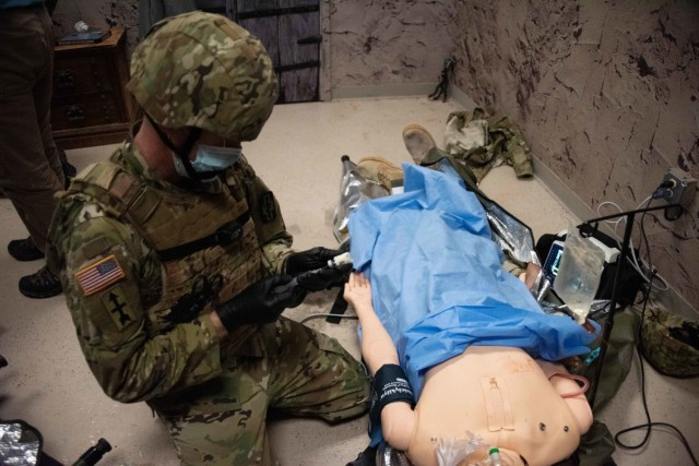 An Army paramedic tends to a simulated patient Jan. 11, 2021, during paramedic training at the Fort McCoy, Wis., Medical Simulation Training Center. The center is managed by the Directorate of Plans, Training, Mobilization and Security at Fort McCoy. (U.S. Army Photo by Greg Mason, Fort McCoy Multimedia-Visual Information Office)