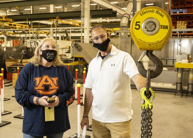 Shawn Ankerich (right), safety and occupational health specialist, explains to Melody Lloyd, a driver tester, the importance of inspecting rigging prior to use. It is important to only use rigging that meets the safety requirements outlined in OSHA 1910.184 and OSHA 1926.251 regulations.