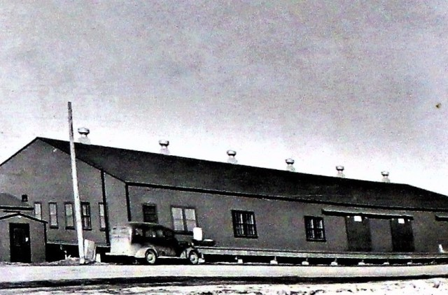 This photo, from April 15, 1940, shows the commissary warehouse that once stood on South Post at Fort McCoy, Wis. The installation was called Camp McCoy in 1940. The photo is one of many found in a forgotten file cabinet in 2020 in one of Fort McCoy's oldest buildings. It's part of a real property record for the post. In late 2020, Fort McCoy Archaeologist Ryan Howell with the Directorate of Public Works Environmental Division Natural Resources Branch was alerted to an old filing cabinet in one of the post's older buildings that contained decades-old real property books. Howell said the find, which includes dozens of photos and documents about now-demolished architecture on Fort McCoy's South Post, is special. It offers a variety of information about what the installation was like from 1909 to the early 1940s, including a full description of the installation's oldest remaining structures. (U.S. Army Historical Photo)