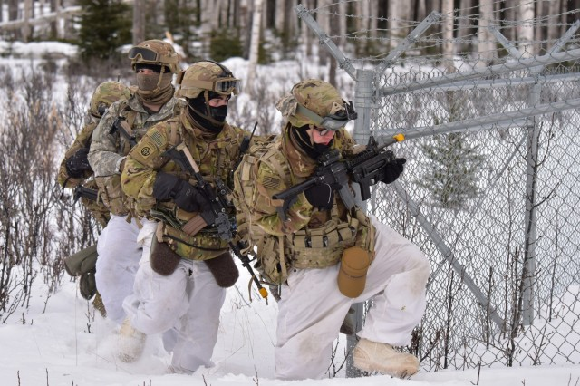 Paratroopers from the 509th Parachute Infantry Regiment attack the Combined Arms Collective Training Facility in the Donnelly Training Area, Alaska, Feb. 11, 2021, as part of the Arctic Warrior exercise. The Army is currently conducting a gap analysis as part of its new Arctic strategy to identify if any new equipment or training sites will be needed or expanded to prepare Soldiers for upcoming missions in extreme cold weather.