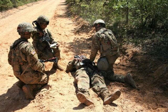 Spc. Zahraa Frelund (kneeling middle), then a private first class, requests medical evacuation for a simulated casualty during One Station Unit Training at Fort Benning, Georgia in 2019. Though Frelund's initial entry training was interrupted by the illness of her daughter, Frelund returned to OSUT more determined than ever to complete training and serve in the U.S. Army. (Photo courtesy of Spc. Zahraa Frelund)