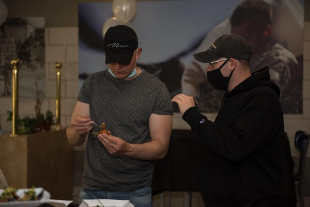 Pfc. Michael Corrales (right) and Pfc. Christopher Vandonsel, 303rd Military Intelligence Battalion, give their opinions on the foods being sampled.  The 61st Quartermaster Battalion held the inaugural Taste Fest event at the Always Ready Warrior Restaurant to test out their modernized menu. (U.S. Army photo by Sgt. 1st Class Kelvin Ringold)