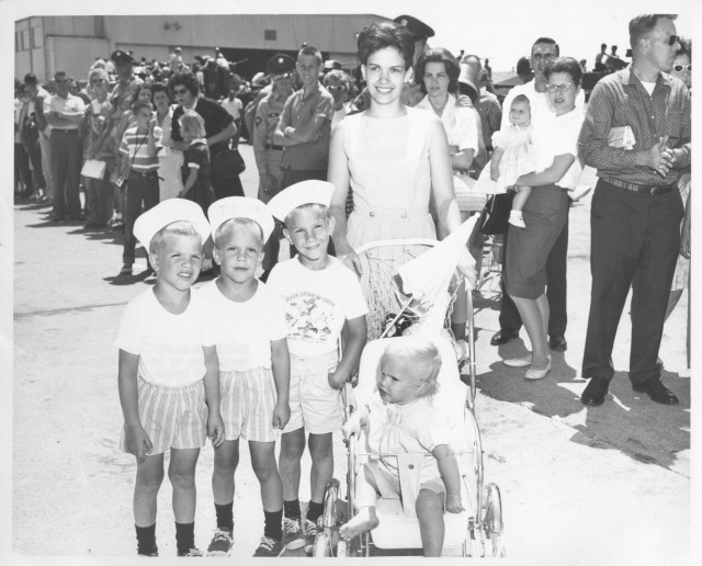 An Army wife takes her children to the 1963 Fort Knox Armed Forces Day celebration. Throughout history, military wives have created community together, often when husbands were away at war.