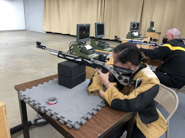 Army Trials athletes 1st Lt. Angelica Forero (left) and Command Sgt. Maj. Thomas Amason (right) trained at the Fort Benning Army Marksmanship Unit, Ga. on March 4, 2021. In addition to air rifle, Forero competed in rowing, cycling and archery during the 2021 Army Trials. (Photo courtesy Annalise Doyle)