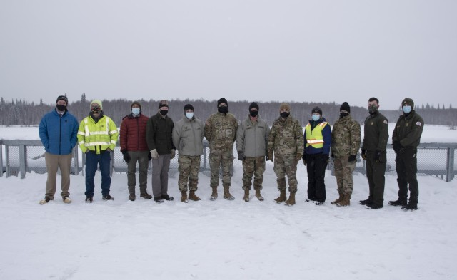 Maj. Gen. William Graham, deputy commanding general of civil and emergency operations for the U.S. Army Corps of Engineers (sixth from left), stands on the control works of the Moose Creek Dam with representatives of the Chena River Lakes Flood Control project on Feb. 19 near North Pole. The team's primary responsibility is to maintain and operate the Chena River Lakes Flood Control Project to protect downtown Fairbanks from flooding.