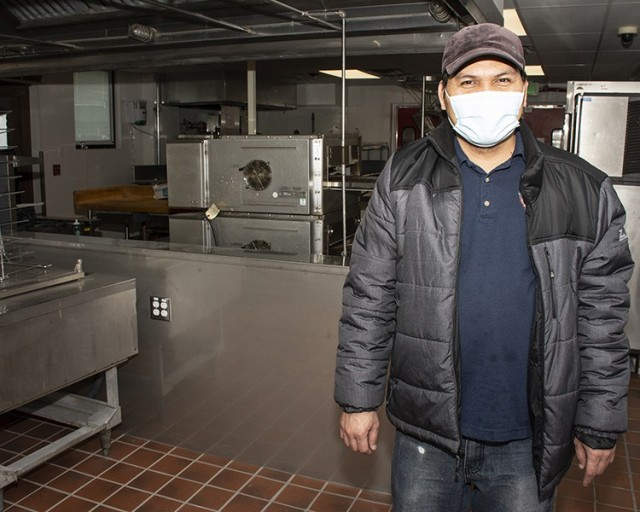 Jinky Tulabot, food and beverage manager, radiates a smile through his mask as he stands in the newly renovated kitchen at the Community Club. After being closed two years for renovation, the club reopened March 8, 2021. Photo by Al Vogel, Dugway Public Affairs