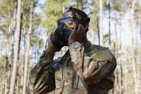 Staff Sgt. Namon Bledsoe dons a protective gas mask during a chemical, biological, radiological, and nuclear training exercise. When used properly, protective gas masks and mission oriented protective posture gear minimizes a Soldier's exposure to possible CBRN environments. (U.S. Army photo by Spc. Aaliyah Craven)