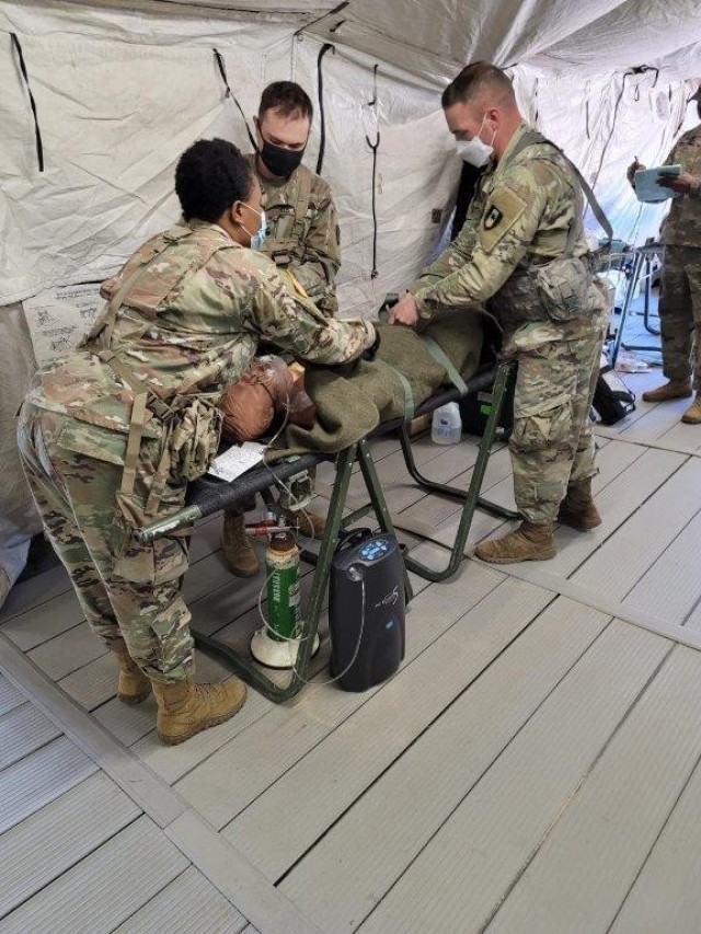 Soldiers with the 36th Medical Care Area Support, 44th Medical Brigade at Fort Bragg, perform realistic medical scenarios during a Field Oxygen Generator Resource test. (Photo by USAMEDDBD)