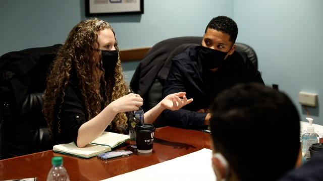 """Spc. Brittney Verberkmoes participates in a group discussion about suicide during a """"people first"""" themed solarium at the U.S. Military Academy in West Point, N.Y., March 15-19, 2021. Verberkmoes is a multimedia illustrator with the 95th Civil Affairs Brigade on Fort Bragg, N.C."""