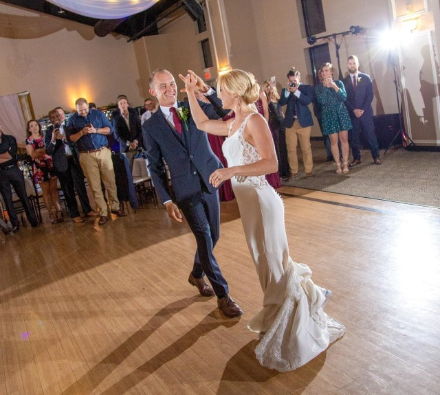 Sgt. Samantha Schultz dances with her husband, Karl Schultz, at the couple's wedding in 2019. Samantha credited Karl with helping her refocus after narrowly missing the 2016 Rio de Janeiro Olympics. Samantha Schultz has qualified to compete in the Olympics in Tokyo.