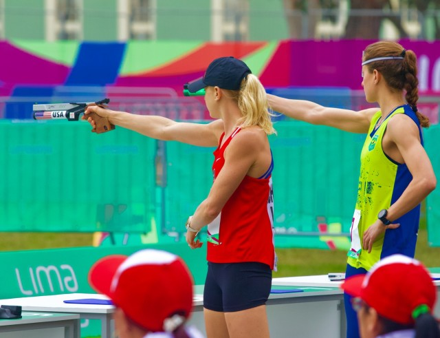Samantha Schultz competes in the running and shooting race of the modern pentathlon. During the event, competitors must hit targets with laser pistols and then complete a 3,200 meter cross country course.
