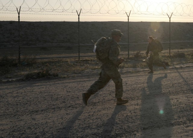 Soldiers competed in the March 7, 2021 running of the Norwegian Foot March at Camp Arifjan, Kuwait, cross paths under the desert sun. The NFM requires Soldiers to complete the 18.6-mile course with a 25-pound ruck in the time set for  their age grouping. The Norwegian Army created the NFM for its own soldiers in 1915 and it has now become a U.S. military tradition. (U.S. Army photo by Staff Sgt. Neil W. McCabe)