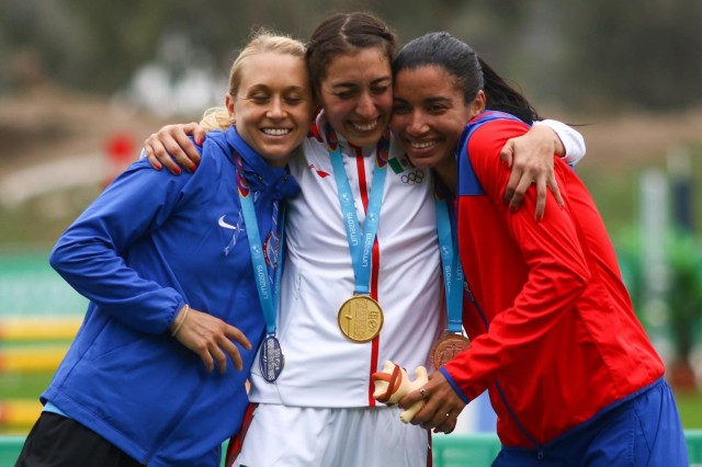 Samantha Schultz, left, shares a happy moment with Mexico's  Mariana Arceo, center, and Cuba's Leydi Moya during medal ceremonies of the 2019 Pan American Games in Lima, Peru. Schultz's silver place finish qualified the Soldier to compete in the Olympic Games in Tokyo. She must still be formally be selected to compete in the games.