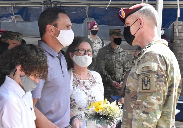 Brig. Gen. David S. Doyle, Joint Readiness Training Center and Fort Polk commanding general, speaks with Jason Maks, son of 1st Lt. Joseph D. Maks, a UH-60A helicopter pilot, and Sue Maks, his widow, as her grandson, Dustin, looks on.