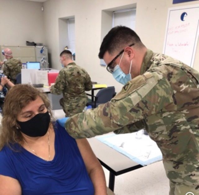Combat medic's most tense moment – vaccinating his mom