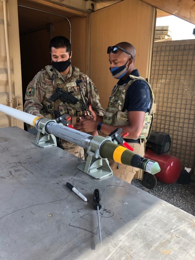Bradley (right) with an Air Force Advisor assembling an Advanced Precision Kill Weapon System (APKWS) in Afghanistan.