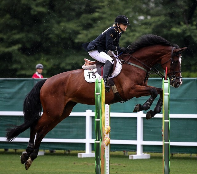Sgt. Samantha Schultz began taking equestrian lessons at age 8, which prepared her for the equestrian show jumping in the modern pentathlon, one of the sport's five disciplines.