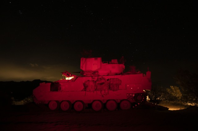 U.S. Army forward observers assigned to the 2nd Battalion, 3rd Field Artillery Regiment, 1st Armored Brigade Combat Team, 1st Armored Division, use their M2 Bradley during a night fire exercise at the Dona Ana Range Complex, NM, March 8, 2021. The job of forward observers is to relay information to the fire direction center on where rounds impact. (U.S. Army photo by Pfc. Elijah Ingram)