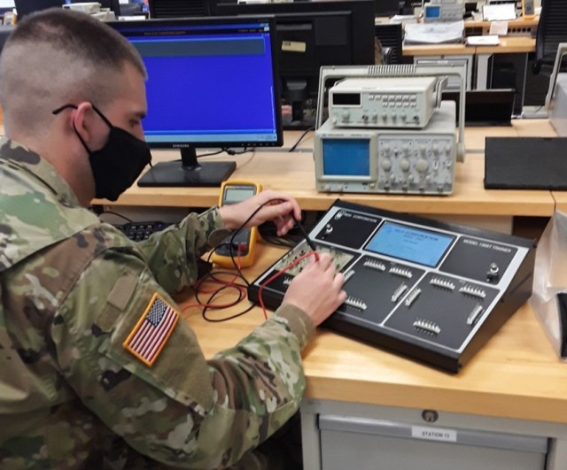 Pvt. Garrett Chance measures resistance using new BEMT-II console as part of his training to be a 94H Test, Measurement and Diagnostic Equipment Maintenance Support Specialist at the U.S. Army Ordnance School, Fort Lee, Virginia.