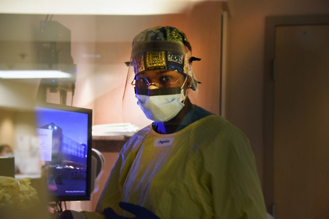 U.S. Army Reserve Capt. Tanisha Nagel, a registered nurse with U.S. Army Reserve Urban Augmentation Medical Task Force 328-1 assigned to support Yuma Regional Medical Center in Yuma, Ariz., inputs her patient's vitals into the hospital computer system, Jan. 30, 2021. After only one year of being in the Army Reserve, Nagle is mobilized under the 807th Medical Command (Deployment Support) as a member of UAMTF 328-1 to provide COVID-19 military medical relief alongside civilian counterparts at YRMC. U.S. Northern Command, through U.S. Army North, remains committed to providing flexible Department of Defense support to the whole-of-government COVID-19 response. (U.S. Army photo by Master Sgt. Helen Miller)