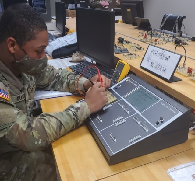 Pvt. Jacob Taylor measures voltage using the new BEMT-II console as a part of his 91D Tactical Power Generation Specialist training at the U.S. Army Ordnance School, Fort Lee, Virginia.
