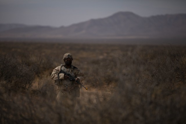 Pfc. Herman Lloyd, a U.S. Army Soldier assigned to 2nd Battalion, 3rd Field Artillery Regiment, 1st Armored Brigade Combat Team, 1st Armored Division, conducts a perimeter sweep during a battalion level field training exercise at the Dona Ana Range Complex, NM, March 7, 2021. 2-3FA conducted this exercise in preparation for an upcoming National Training Center rotation. (U.S. Army photo by Pfc. Elijah Ingram)