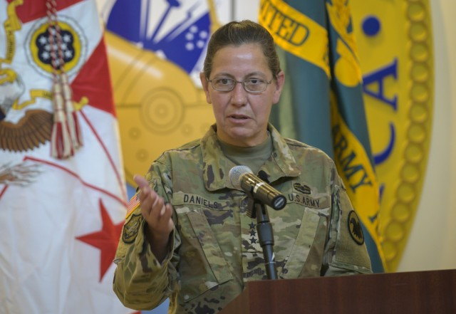 Lt. Gen. Jody J. Daniels, chief of Army Reserve, speaks during her assumption of command ceremony at Fort Bragg, N.C., July 28, 2020. As the first woman to lead the 200,000-strong force since its inception in 1908, Daniels hopes to be remembered as a torchbearer for future leaders to fill the Army ranks at its highest levels, she said.