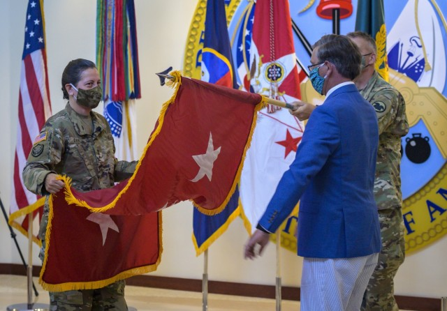 Lt. Gen. Jody J. Daniels, left, the chief of Army Reserve, unveils a three-star flag during her assumption of command ceremony at Fort Bragg, N.C., July 28, 2020. As the first woman to lead the 200,000-strong force since its inception in 1908, Daniels hopes to be remembered as a torchbearer for future leaders to fill the Army ranks at its highest levels, she said.