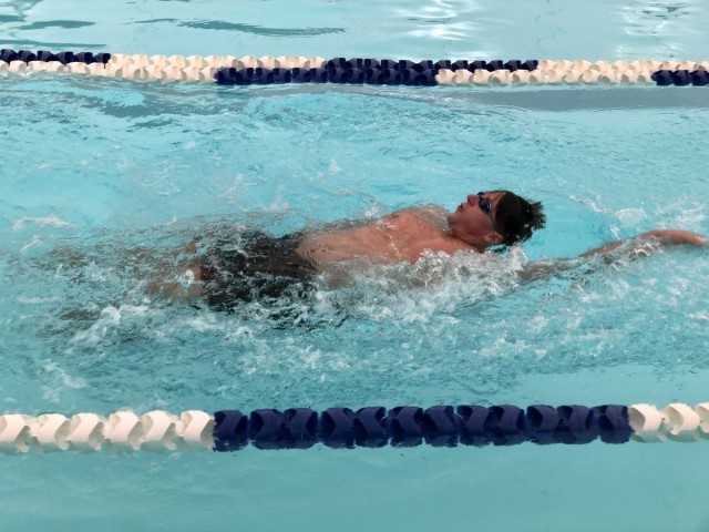 Sgt. Jared Babinski competes in the 50-meter backstroke swimming event. (Photo via Robyn Womac)