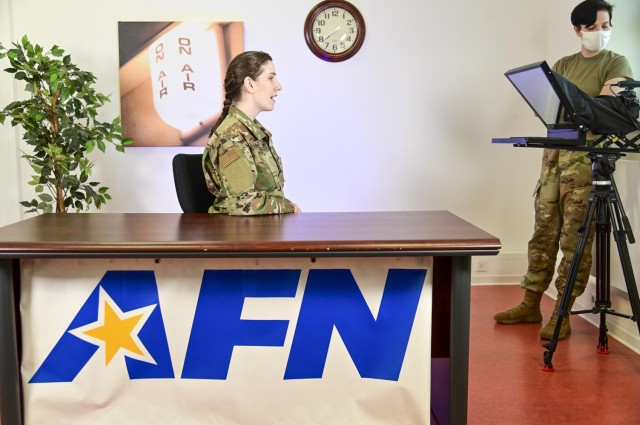 AFN Stuttgart's Air Force Staff Sgt. Krystal Wright wears her hair in a newly authorized braid at work.