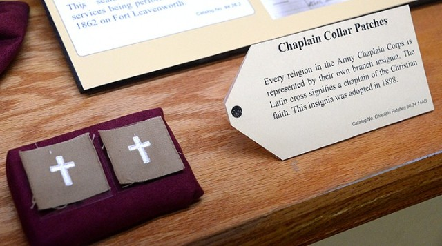 These chaplain collar patches are part of a new exhibit at the Frontier Army Museum highlighting Fort Leavenworth chaplains. The Latin cross, insignia adopted in 1898, signifies a chaplain of the Christian faith. Photo by Prudence Siebert/Fort Leavenworth Lamp