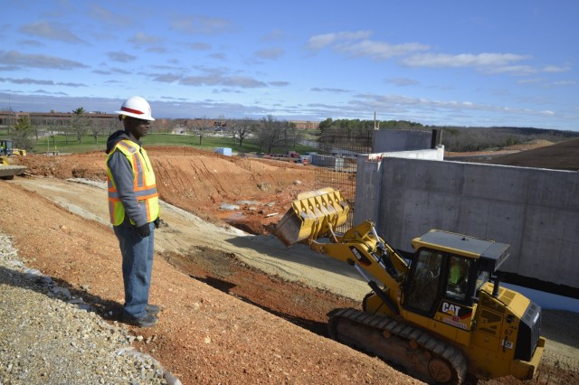 Sgt. 1st Class Abu Sesay, a senior construction supervisor assigned to the 554th Engineer Battalion, surveys the project site for the new General Leonard Wood Army Community Hospital March 24.