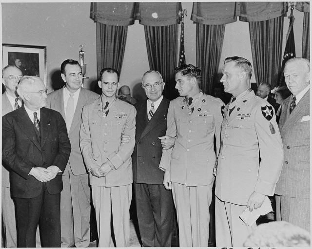 Kouma (in uniform at right) receives his Medal of Honor from President Harry S. Truman.