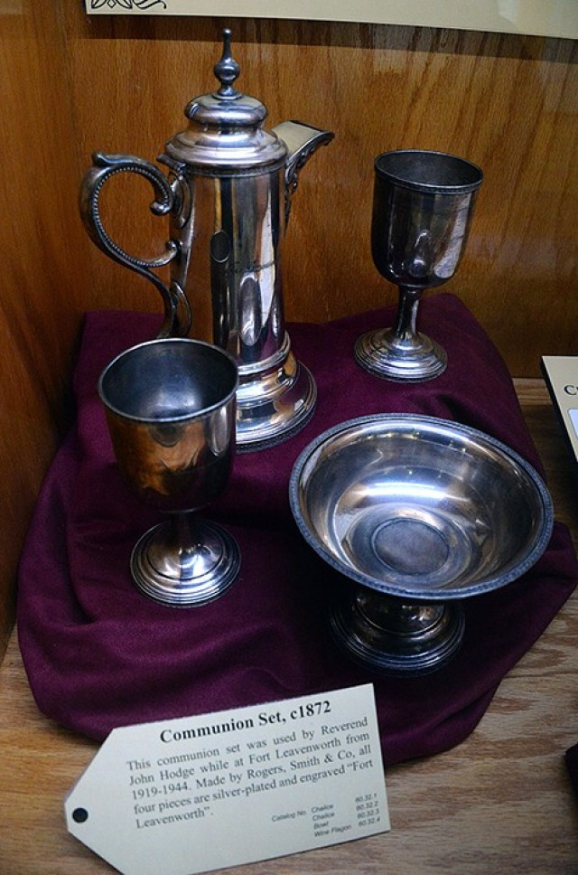 This circa 1872 silver-plated Communion set, which includes two chalices, a bowl and a wine flagon, is part of the new Frontier Army Museum exhibit highlighting Fort Leavenworth chaplains. The set was used by Rev. John Hodge, who served at Fort Leavenworth from 1919-1944. Photo by Prudence Siebert/Fort Leavenworth Lamp