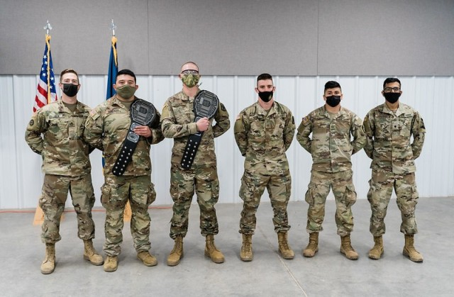 Competitors of the 2021 Kansas Army National Guard Best Warrior Competition pose for a group photo Mar. 21 in Salina, Kansas. From left to right, Sgt. Anthony Bien, 635th Regional Support Group; Sgt. Andrew Gonzales, 1st Battalion, 635th Armor Regiment; Spc. Nikolas Decker, 2nd Battalion, 130th Field Artillery; Pfc. Cooper Ross, 130th Field Artillery Brigade; Pfc. Christian Radabaugh, 1st Battalion, 635th Armor Regiment; and Spc. Sai Chadalawada, 635th Regional Support Group.