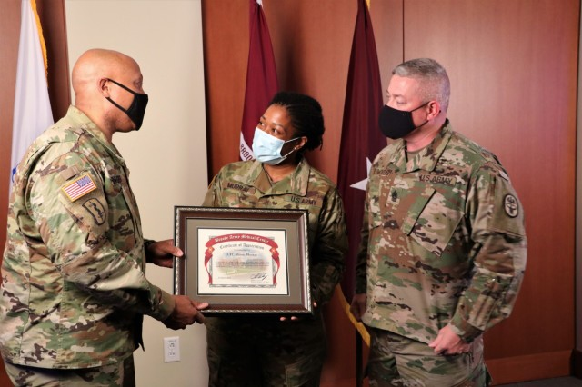Brooke Army Medical Center Commanding General, U.S. Army Brig. Gen. Shan Bagby, left, and Command Sgt. Maj. Thurman Reynolds, right, present Lt. Col. Alison Murray, chief medical information officer, a certificate of appreciation for being the guest speaker during BAMC's Virtual Women's History Month Observation, March 23, 2021. BAMC broadcasted the event on Facebook live in order to social distance during the current COVID-19 pandemic. (U.S. Army photo by Robert A. Whetstone)