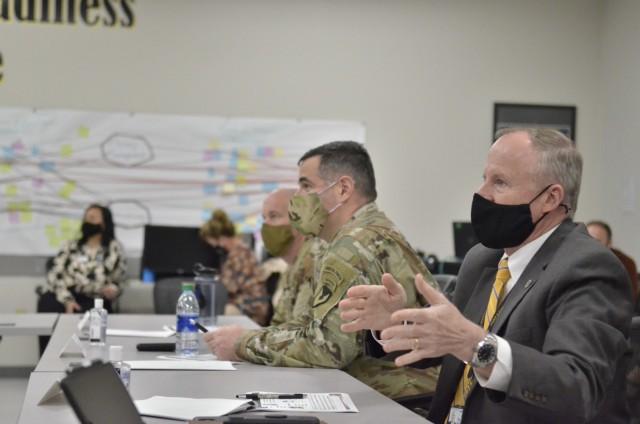 Colonel Jeremy D. Bell, Fort Campbell garrison commander, and Jonathan Hunter, Fort Campbell deputy garrison commander, offer feedback on the Leadership Fort Campbell 2.0 cohort's presentation March 18 at the Garrison Learning Center.
